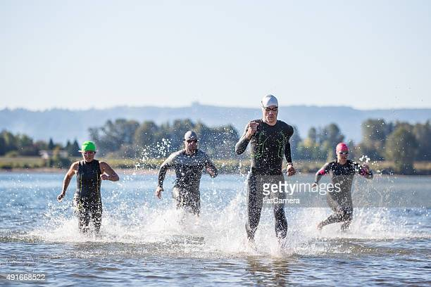 triathletes training for a triathlon - triathlon stock pictures, royalty-free photos & images