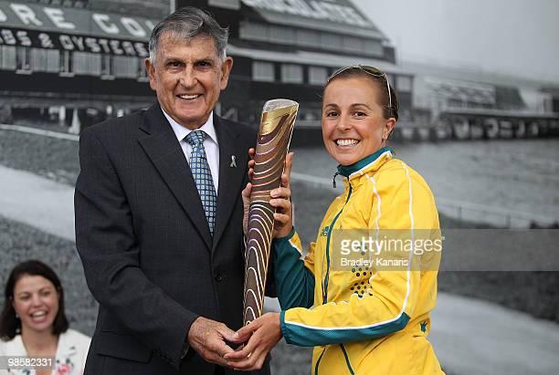 Triathlon champion Emma Snowsill of Australia hands over the Queens Baton to Gold Coast Lord Mayor Ron Clarke as part of the Delhi 2010 Commonwealth...