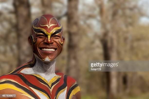 tribal african man with body paint outdoors. hunter, warrior. forest. - african tribal culture stock pictures, royalty-free photos & images