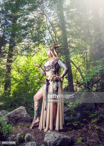 tribal belly dancer in the woods - belly dancing stock photos and pictures