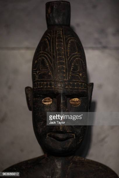 A tribal carved wooden food hook hangs on a wall during a press preview at Summers Place Auctions on May 30 2018 in Billingshurst England Summers...