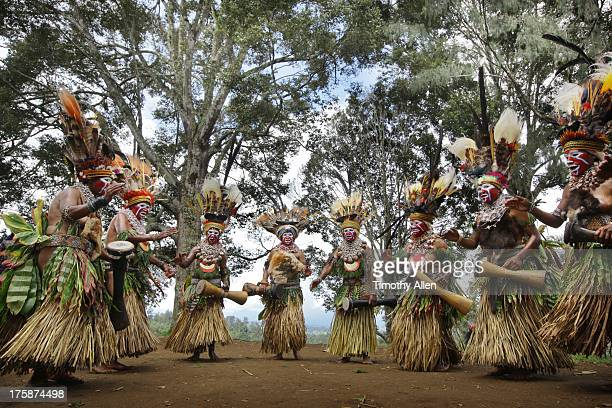 Tribal clan women sing, dance and play drums