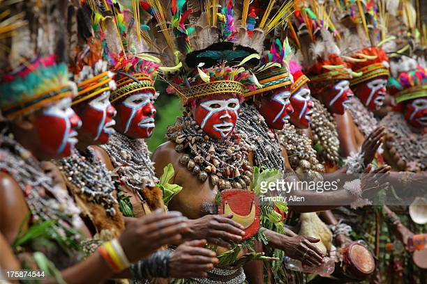 Tribal clan women singing and playing drums