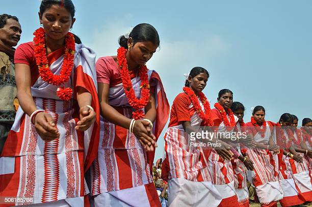 Tribal dancers performs during a protest meeting organised by Communist Party of India Liberation against state government of West Bengal in Kolkata...