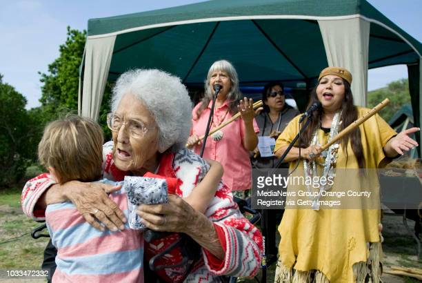 Tribal elder Adela 'Peachy' OliverasValenzuela gets hugs during the 10th anniversary celebration of Pahne an indigenous village bordering San...