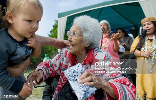 Tribal elder Adela 'Peachy' OliverasValenzuela is greets people including Dason Enquist during the 10th anniversary celebration of Pahne an...