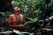 Tribal elder Binan Tukum hunting with his son for monkeys in the rainforest