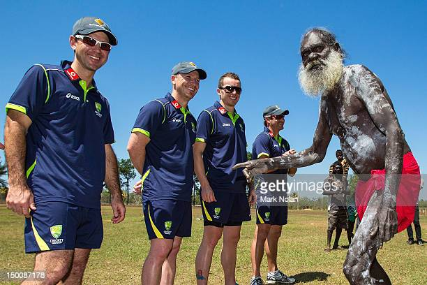 A tribal elder performs a welcome to land ceremony to Ricky Ponting Brad Haddin Peter Siddle and Ryan Harris of the Australian cricket team during a...