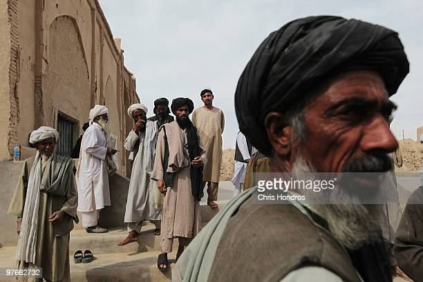 Tribal elders and mullahs from both Pashtun and Balouchi tribes prevalent in southern Helmand province gather after praying together at a rural...