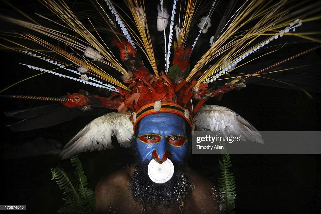 Tribal feather headdress and sea shell nose ring : Stock Photo