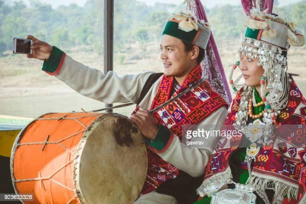 Tribal folk dancer and musicians of Kinnaur taking selfie.