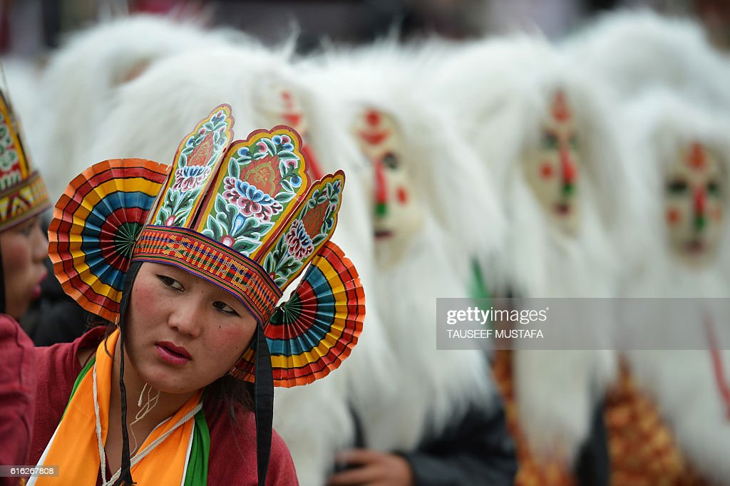 TOPSHOT - A tribal girl looks on during the second day of the three-day Tawang festival in Tawang, near the Indo-China border in north eastern Arunachal Pradesh state on October 22, 2016 The Tawang Festival 2016 runs from October 21 with a three-day programme to promote tourism and showcase the culture and traditions of the district in particular, and the state in general. / AFP / TAUSEEF