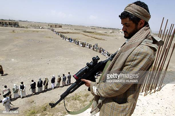 A tribal gunman loyal to the ShiiteHuthi movement stands with his weapon during a gathering against the Saudiled intervention in the country in the...