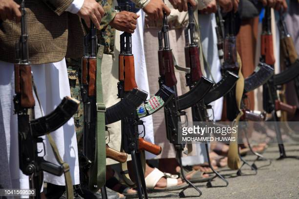 TOPSHOT Tribal gunmen loyal to the Huthi movement brandish their weapons during a gathering in Sanaa to show support to the Shiite Huthi militia...