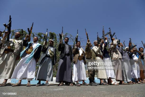 Tribal gunmen loyal to the Huthi movement brandish their weapons during a gathering in Sanaa to show support to the Shiite Huthi militia against the...