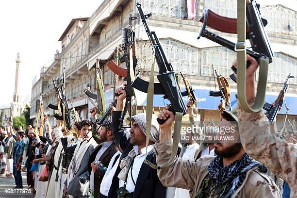 Tribal gunmen loyal to the Huthi movement brandish their weapons in the capital Sanaa on April 1 during a demonstration against Saudiled coalitions...