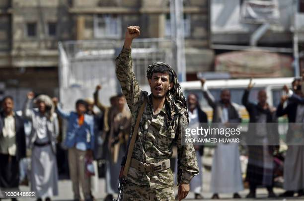 TOPSHOT Tribal gunmen loyal to the Huthi movement chant slogans during a gathering in Sanaa to show support to the Shiite Huthi militia against the...