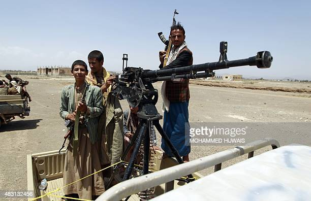 Tribal gunmen loyal to the ShiiteHuthi movement stand in the back of a heavily armed vehicle during a gathering against the Saudiled intervention in...