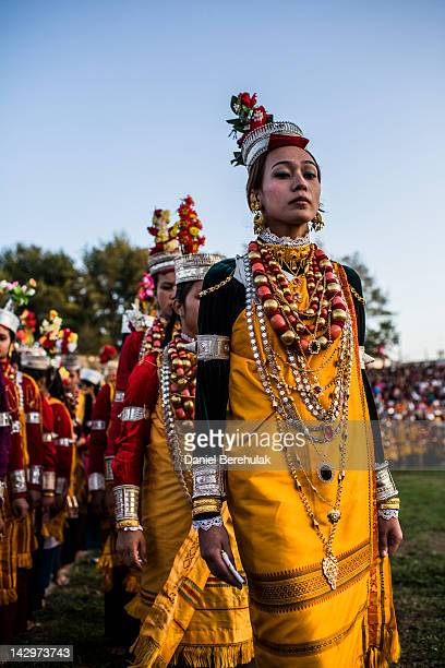 Tribal Khasi maidens and young men dressed in traditional costume participate in a dance during the Shad Suk Mynsiem Festival on April 16 2012 in...