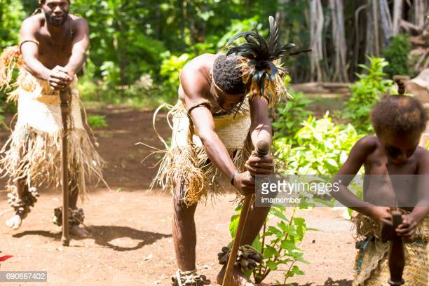 tribal male villagers with young boys performing tribal dance, vanuatu - vanuatu stock photos and pictures