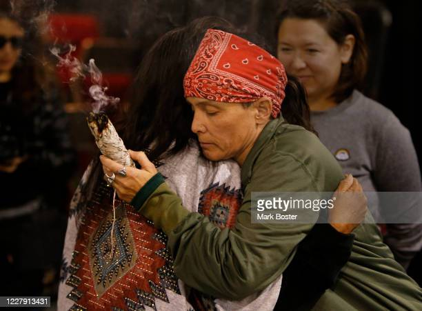 Tribal members hug one another while conducting a cleansing ceremony at the Prairie Knights Casino near Fort Yates North Dakota for the veterans who...