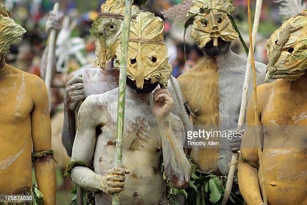 Tribal men with leaf masks