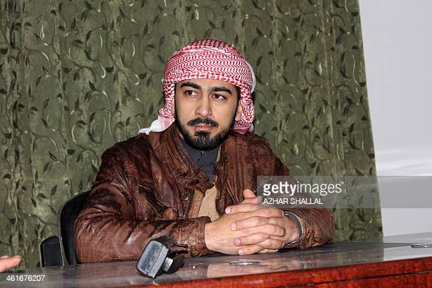 A tribal militia commander Mohammed Khamis Abu Risha sits at a desk in a building in Malaab a district of the Iraqi city of Ramadi on January 9 2014...
