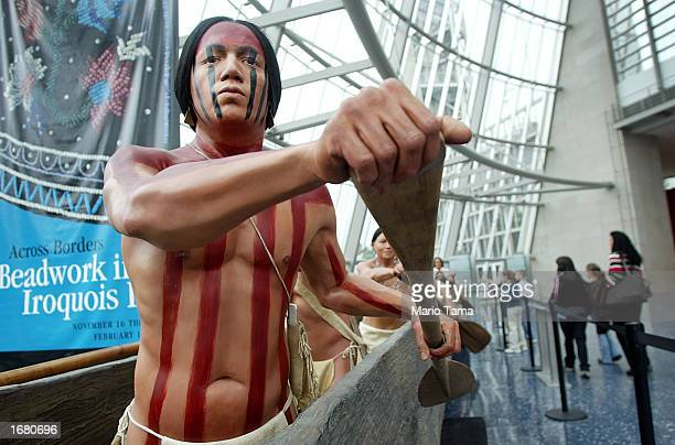 A tribal model canoe is on display inside the $193 million Mashantucket Pequot Museum and Research Center November 21 2002 in Mashantucket...