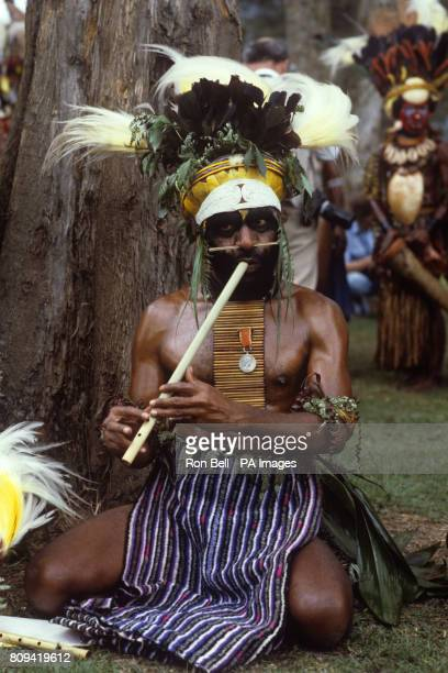 A tribal musician plays for the Royal party during the Singsing held at the Old Golf course Mt Hagen Papua New Guinea