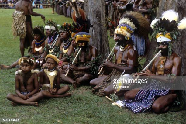 Tribal musicians play their reed like instruments during the Singsing held at the Old Golf course Mt Hagen Papua New Guinea