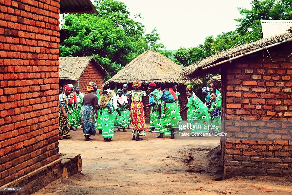 Tribal people performing traditional dance in village : Stock Photo