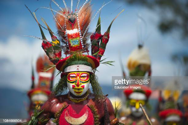 Tribal performers at Singsing Mt Hagen Show in Western Highlands Papua New Guinea with King of Saxony plumes Raggiana Bird of Paradise plumes and...