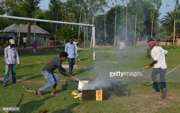 Tribal villagers burn a ballot box during 'panchayat' elections the most local tier of governance in India at Malda district in the Indian state of...