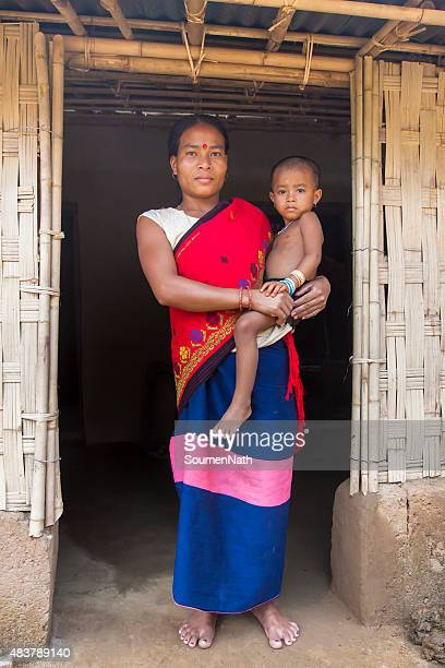 tribal woman from india with her child in traditional attire - tripura state stock pictures, royalty-free photos & images