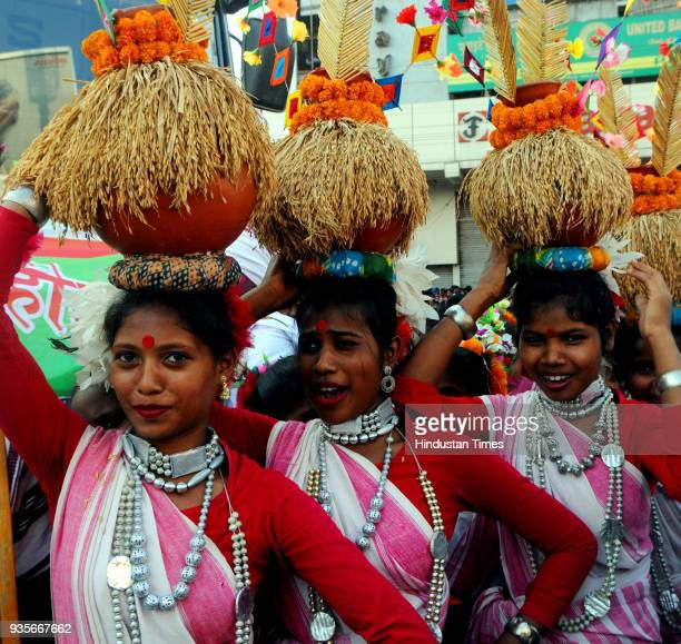 Tribal youths with their traditional dresses take part in Sarhul Festival procession on March 20 2018 in Ranchi India The festival marks the...