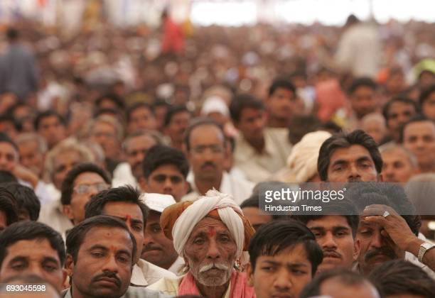 Tribals listen to Narendra Modi on the first day of Shabri Kumbh festival at dang district of Gujrat