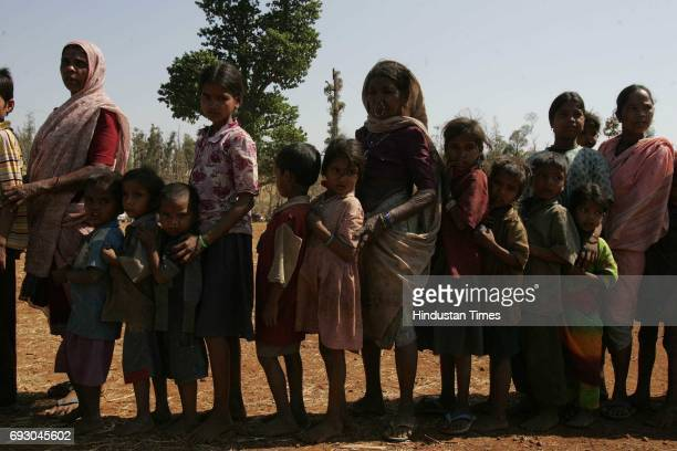 Tribals waits in a food queue at 'shabri kumbh festival' at shabridham in dang district of Gujrat