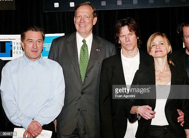 Tribeca Film Festival cofounder Robert De Niro New York State Governor George Pataki and actors Kevin Bacon and Kyra Sedgwick pose together at the...