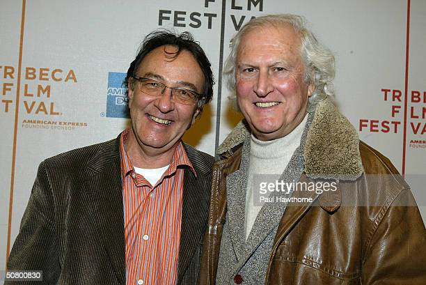 Tribeca Film Festival Executive Director Peter Scarlet and Director Fernando Solanas pose at the screening of 'A Social Genocide' during the 2004...