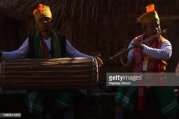 tribes of nagaland at hornbill festival - bamboo flute stock-fotos und bilder