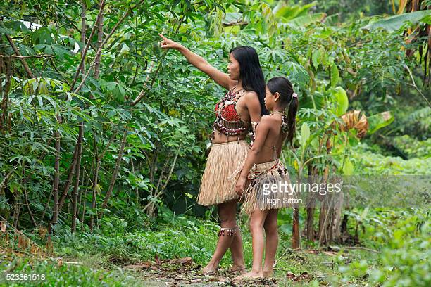 Tribes people (8-9) from Amazon rainforest, Amazon River Basin, Ecuador
