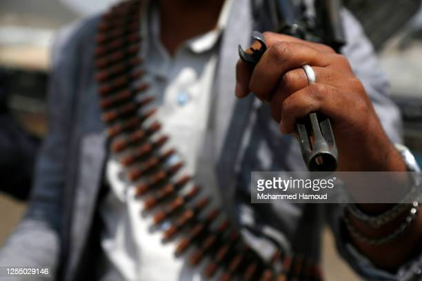 Tribesman loyal to the Houthi group carries his gun as he participates in an armed tribal gathering on July 08, 2020 on the outskirts of Sana'a,...
