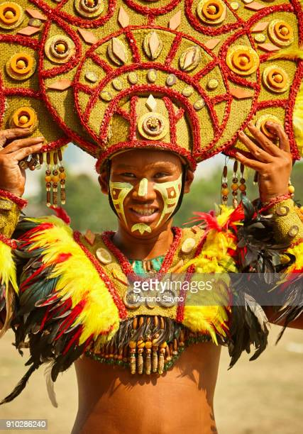 tribesman wearing giant head dress at festival - dinagyang festival stock photos and pictures