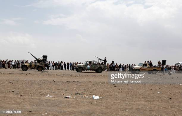 Tribesmen loyal to the Houthi group parade with trucks during an armed tribal gathering on July 08, 2020 on the outskirts of Sana'a, Yemen. Yemen,...