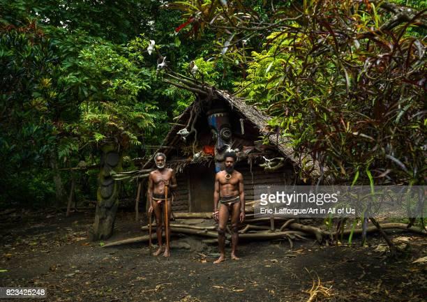 Tribesmen standing in front of the nakamal house Ambrym island Fanla Vanuatu on August 29 2007 in Fanla Vanuatu