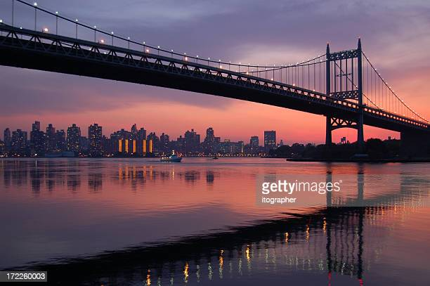 triboro bridge silhouette at sunset - queens new york city stock pictures, royalty-free photos & images