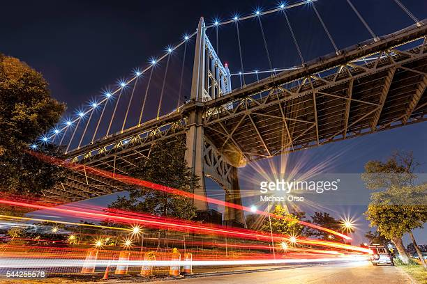 Triborough RFK Bridge. long exposure car traffic trails. Astoria Park NY.