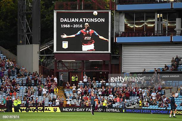 A tribure to Dalian Atkinson is displayed on the big screen inside the stadium prior to the Sky Bet Championship match between Aston Villa and...