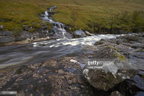 A tributary stream flows into the River Etive in Glen Etive