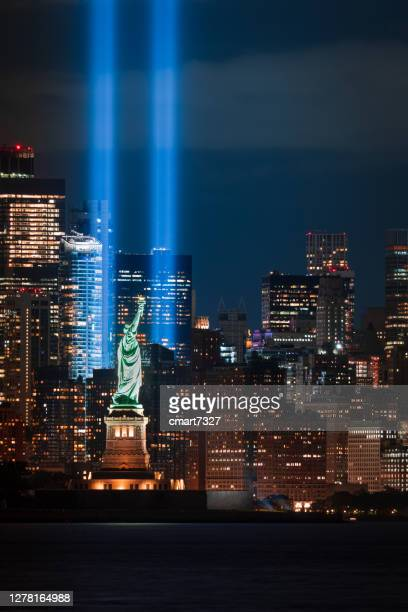 9/11 tribute in light and statue of liberty - new york harbour stock pictures, royalty-free photos & images